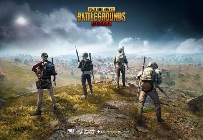 pubg-mobile-lite-teammates-on-a-hill-carrying-guns-staring-down-at-a-town