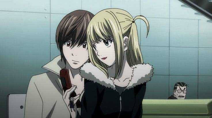 Misa Amane Light Yagami Death Note sitting on lap looking at phone dad in background